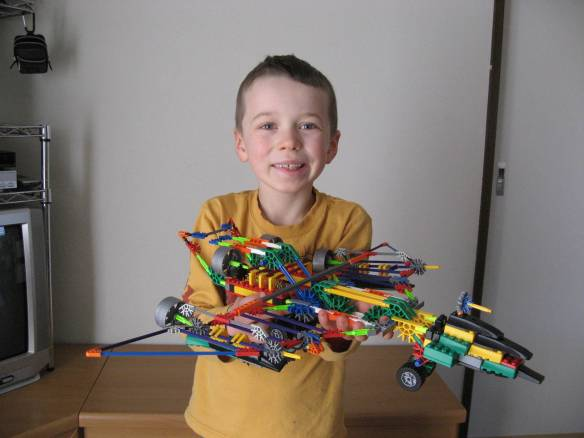 Posing proudly with a jet that he and Ethan made from K'nex blocks