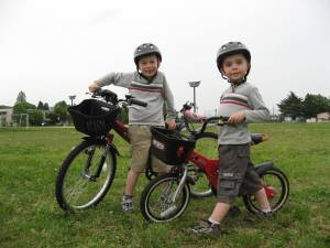 "Since Ausitn moved up to a bigger bicycle, Austin's old bike (dubbed ""Top Speed"") became Ethan's.  Here he is posing proudly after graduating from training wheels."