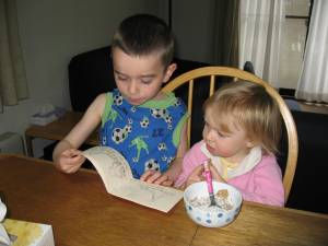 Ethan is working hard at learning to read.  He recently sat down with Katie at breakfast to try to help her learn to read too.