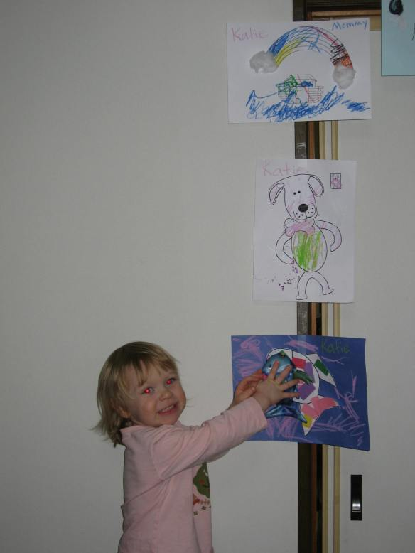 Katie proudly poses with some of the crafts she did in my preschool English class.