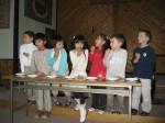 Austin and Ethan and their classmates tasting their cream puffs.