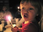 Katie was very excited about getting to hold a lit candle!