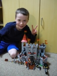 Austin posing proudly with his completed castle.