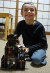 Ethan posing with his castle.
