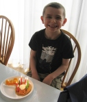 Ethan left for America on the morning of his 8th birthday, so we celebrated by eating chocolate chip birthday pancakes.