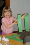 Katie was in charge of making the grass to decorate the leapfrog game