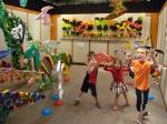 Crazy kids looking at crazy dinosaur art