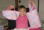 Katie's preschool teacher made her these adorable bags for holding her lunch and her books.