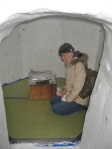 Yoshie inside one of the igloos that had a tatami mat and a barbeque stove inside of it.
