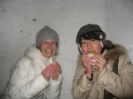 Yoshie and I munching on nikuman (steamed bread with meat inside) as we relaxed inside an igloo.