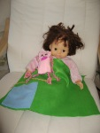 Even Katie's doll benefits from her blossoming sewing skills.