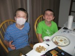 Austin and Ethan building their cell cake.  (Austin had a cold and in Japan people wear masks to protect others from their cold germs).