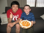 Ethan with his buddy Kento and his birthday pumpkin pie.